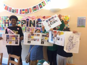 Women holding up their collages
